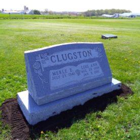 Gray stone slant memorial.