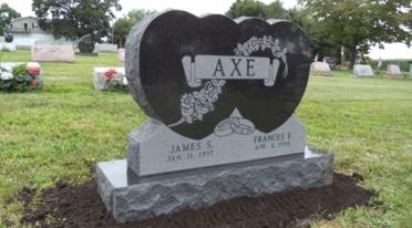 Ornate granite headstone.