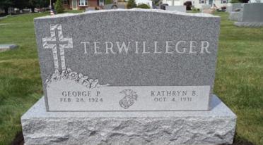 Custom engraved memorial granite headstone.