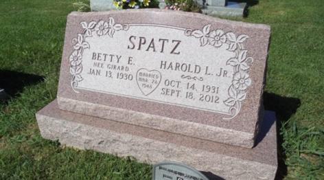 Custom red granite slanted memorial headstone.