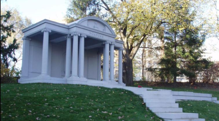 Ornate mausoleum with Greek style columns.